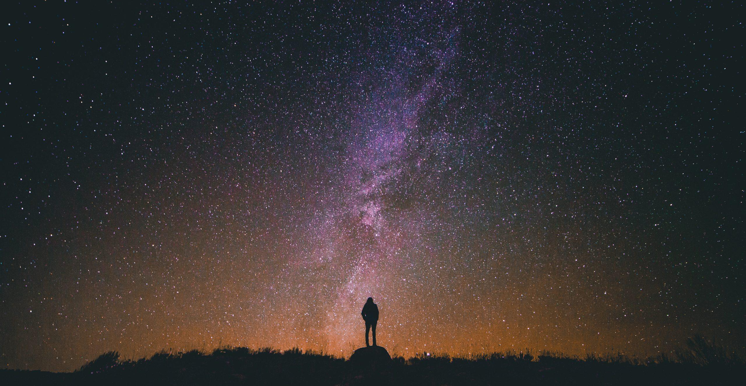 Man standing under the stars