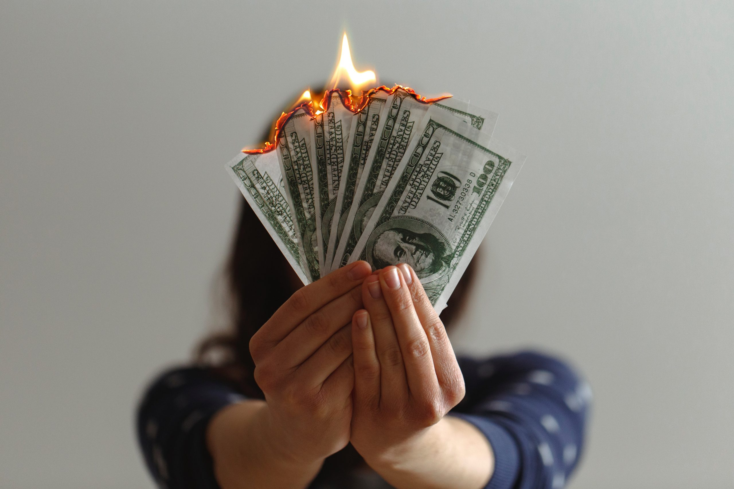 Woman burning money